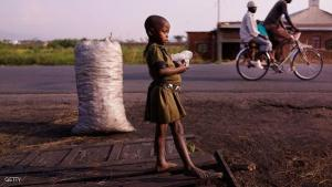 BUJUMBURA, BURUNDI - JUNE 27: A child stands along the roadside on June 27, 2015 in Bujumbura, Burundi. Burundi is one of the worlds poorest countries with food shortages throughout the cities and countryside. The head of Burundi's influential rights group Aprodeh says at least 70 people, mostly civilians, have been killed and hundreds of others wounded following weeks of political unrest in the small and landlocked country in the African Great Lakes region of East Africa. The violence started began President Pierre Nkurunziza announced his controversial bid for a third consecutive five-year term in office. The Office of the UN High Commissioner for Refugees (UNHCR) has said the violence in Burundi has forced more than 100,000 people to flee to neighbouring countries.  (Photo by Spencer Platt/Getty Images)