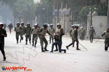 Egyptian army assaulting a woman