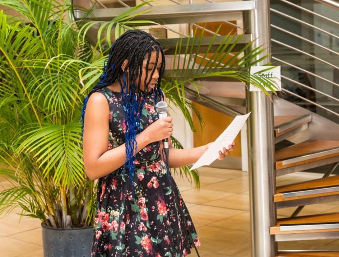 Queen Ogumefu reading her winning entry under 16's Flash Fiction