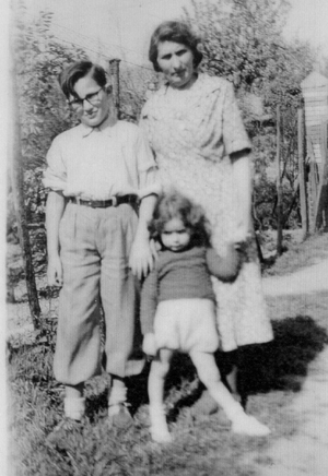 Rene Lichtman, with glasses, with his rescuer Madame Lepage, right after the war, 1945. Other child unknown.