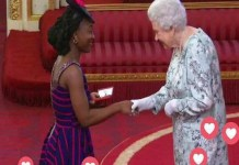 KUMBA MUSA RECEIVING AN AWARD FROM QUEEN ELIZABETH II AS A YOUNG LEADER