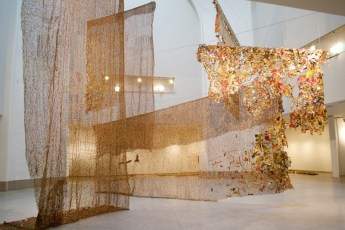 El Anatsui (Ghanaian, Sculpture, b. 1944): Gli (Wall), 2010. Five hanging curtains of found aluminum and copper wire. Art Basel 2016, Basel, Switzerland. 'Unlimited' sector, represented by Jack Shaman Gallery, New York, NY, USA.