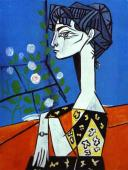 Pablo Picasso (Spanish; Cubism, Later Years; 1881-1973): Jacqueline with Flowers, 1954. Oil on canvas, 116 x 88.5 cm. Musée Picasso, Paris, France. © Pablo Picasso.