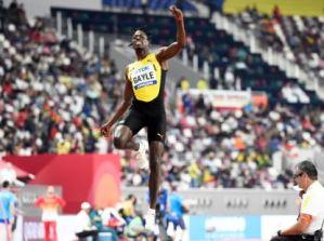 Jamaica's world long jump champion Tajay Gayle sings with Puma