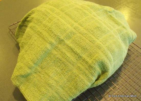Freshly baked Irish brown bread wrapped in a tea towel or cloth to help soften the crust