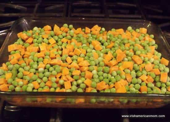 Peas and carrots layer over beef for Shepherd's Pie