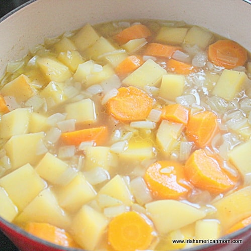 Simmering turnip and carrot soup
