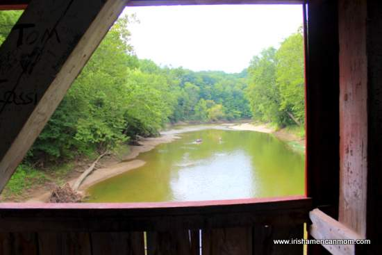 Creek view from inside a covered bridge over Sugar Creek