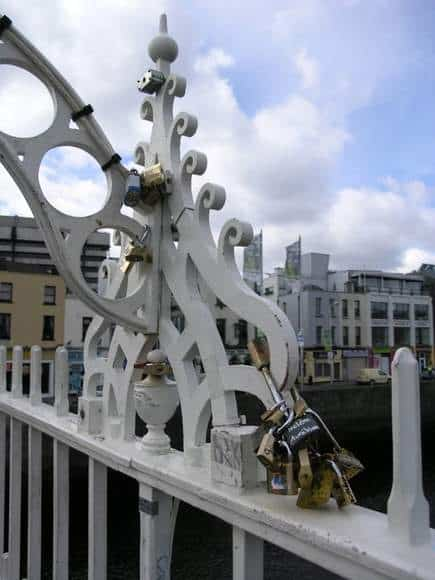 Metal locks attached by couples to the rails of the Ha'penny Bridge in Dublin