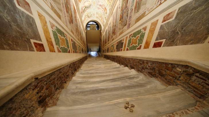 Pilgrims say bare marble of 'Holy Stairs' brings them closer to Christ