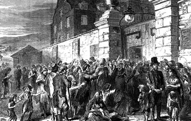 Crowds outside a workhouse doors during the Famine.