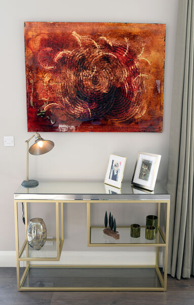 A piece of art in the hallway provided colour inspiration for the interiors scheme. Console table and hall table, available to order through Sinead Cassidy Design; hall table lamp, Lightplan, Kinsale Road.