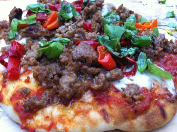 Grilled PIzza with Sausage, Mama Lil's Peppers, and fresh Basil