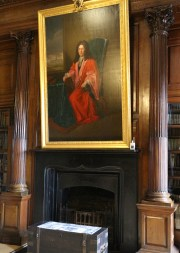Edward Worth's portrait over the fireplace in the library