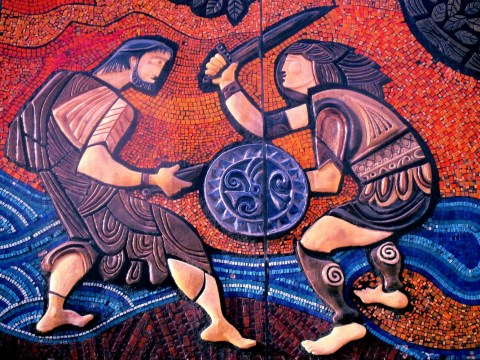 Mural of two Celtic warriors in battle
