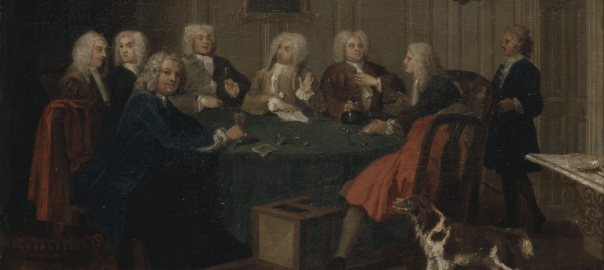 A group of wigged gentlemen sit around a table in discussion. They are attended by a servant and a gun-dog. One man, dressed in blue, stares out at the viewer.