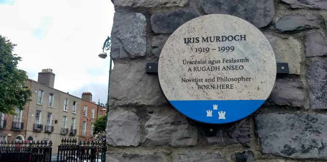 Iris Murdoch plaque at Blessington Basin. The houses outside are at the top of Blessington Street where she was born.