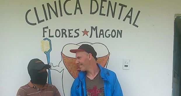 """Michael McCaughan and his """"votan"""", or guadian, David, in front of the dental clinic in Moises Gandhi. Photograph: Sergio Chua"""