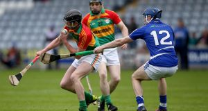 Carlow's Diarmuid Byrne with Laois's Stephen Maher during the Leinster senior hurling championship clash at O'Moore Park, Portlaoise. Photo: Ryan Byrne/Inpho