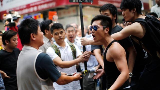 Hong Kong police deny 'working with gangs' to target protestors