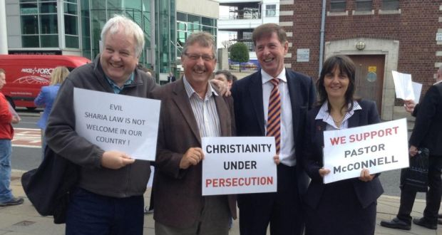 Protesters, including DUP MP Sammy Wilson (second from left), turned up in support of Pastor James McConnell in Belfast.