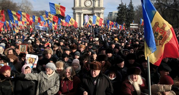 Protesters shout slogans during a large demonstration in Chisinau, Moldotheva, on Sunday. Photograph: Vadim Ghirda/EPA