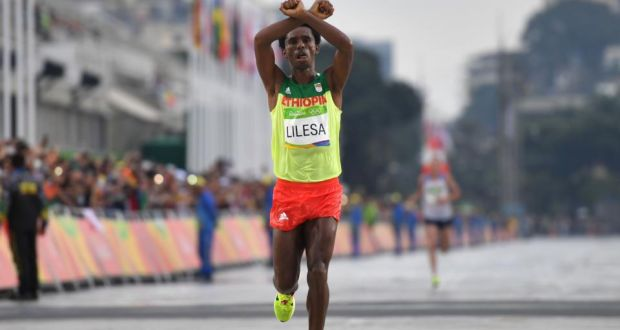 Ethiopia's Feyisa Lilesa makes a gesture after taking the silver medal in the men's marathon at the Olympic Games in Rio. Photograph: Olivier Morin/AFP/Getty Images
