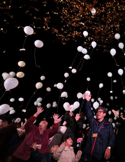 People release balloons, carrying their wishes, to celebrate the New Year at Prince Park Tower in the Japanese capital of TokyoPhotograph: AFP/Getty Images