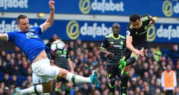Chelsea's Spanish attacker Pedro scores the opening goal at Goodison Park. Photograph: Getty Images