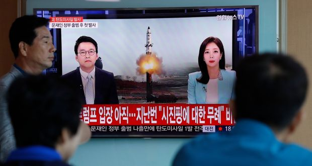 South Koreans watch a television displaying news broadcasts reporting on North Korea's recent ballistic missile launch, at a station in Seoul. Photograph: EPA