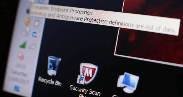 A message on a laptop screen from internet security software - warning users of outdated anti-virus and anti-spyware protection - after 150 countries were hit by a major cyber attack. Photograph: Yui Mok/PA Wire