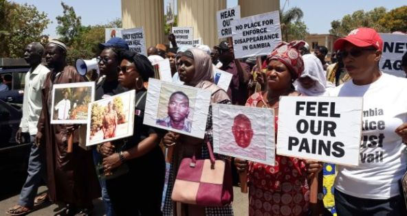 Relatives of victims of the regime of former president Yahya Jammeh demonstrate in Banjul, demanding answers on the state of the investigation on the disappearance of their loved ones.  Photograph: Claire Bargeles/AFP/Getty Images