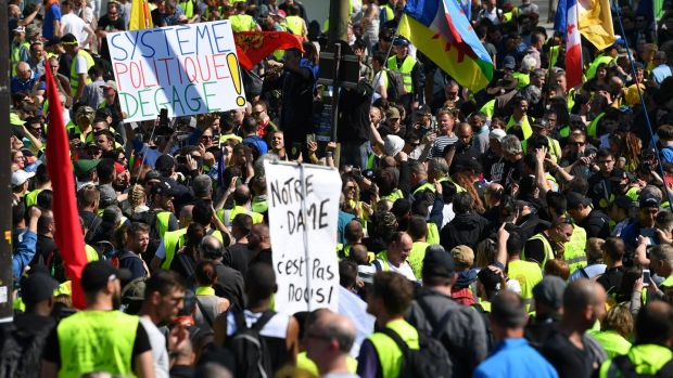 Yellow-vest demonstrators in Paris. Photograph: Jeff J Mitchell/Getty Images