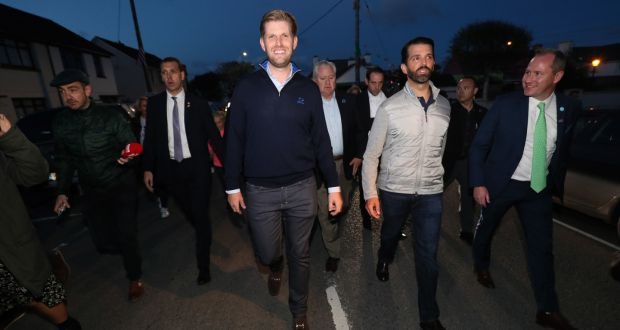 Donald  jnr (second right), and Eric Trump (centre),  in Doonbeg,  with   golf resort director of membership Brendan Murphy (in green tie). Photograph: Brian Lawless/PA
