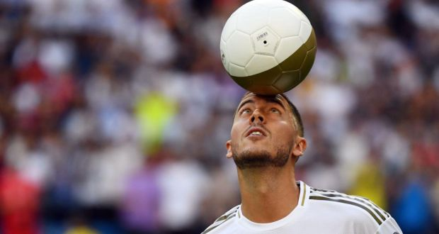 Eden Hazard during his official presentation as a new Real Madrid player at the  Santiago Bernabeu stadium. Photograph:  Gabriel Bouys/AFP/Getty Images