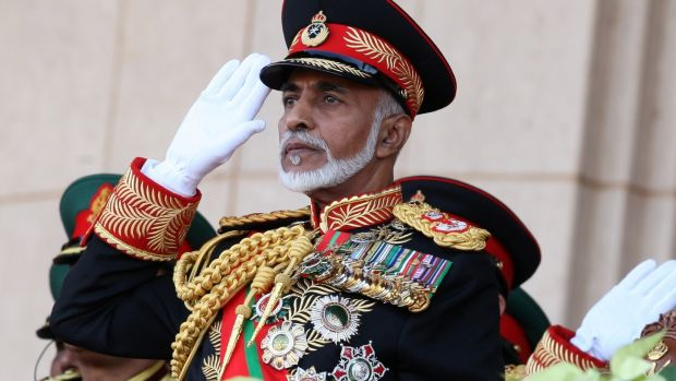 Sultan Qaboos bin Said salutes at the start of a military parade at a stadium in Muscat on the occasion of the Sultanate's 40th National Day in 2010. Photograph: Mohammed Mahjoub/AFP via Getty Images