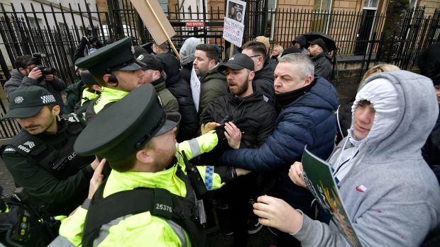 Protesters clash with the police outside Derry Magistrates Court as Paul McIntyre appeared in court on Thursday charged with the murder of Lyra Mckee. Photograph: Getty