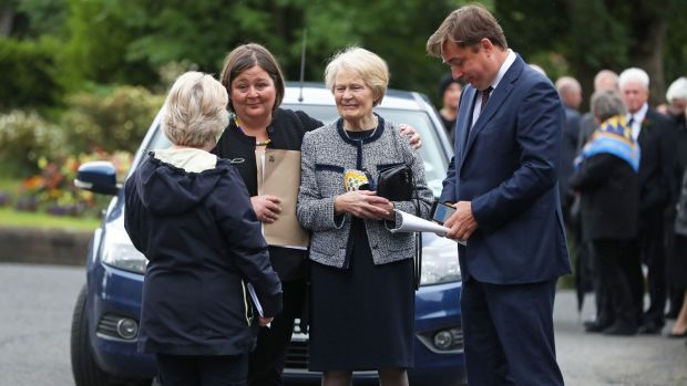 Patricia Hume (centre) arrives at St Eugene's Cathedral in Derry for the funeral of her husband. Photograph: Niall Carson/PA Wire