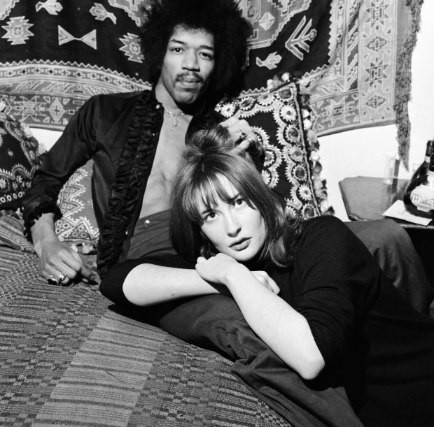 Jimi Hendrix with girlfriend Kathy Etchingham in his Mayfair flat in London, January 1969. Photograph: Eric Harlow/Mirrorpix/Getty Images.