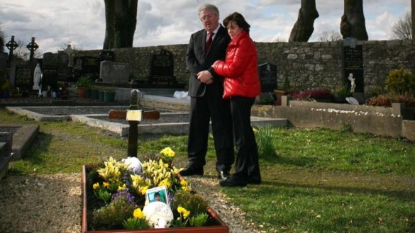 Andrew Dolan's parents, Joe and Rosie, pictured in 2014 at his graveside in Ardcarne Cemetery , Co Roscommon. Photograph: Brian Farrell
