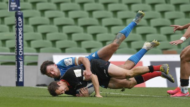 Alex Goode dives to score for Saracens in their win over Leinster. Photograph: Charles McQuillan/Getty