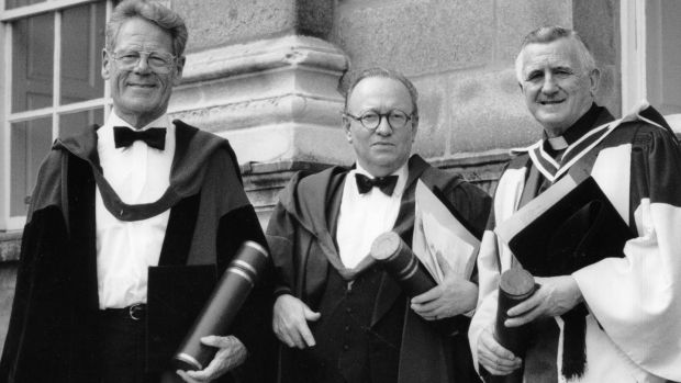 Hans Kung, left, Derek Mahon and Rev Michael Hurley SJ received their honorary degrees at Trinity College in 1995. Photograph: Jack McManus