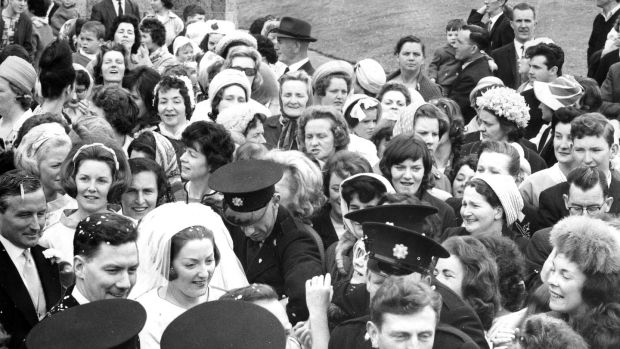 Gay Byrne and Kathleen Watkins being helped through a crowd of about 300 people who surrounded the couple when they left the Church of the Nativity, Saggart, Co Dublin, after their wedding in June 1964. Photograph: Gordon Standing