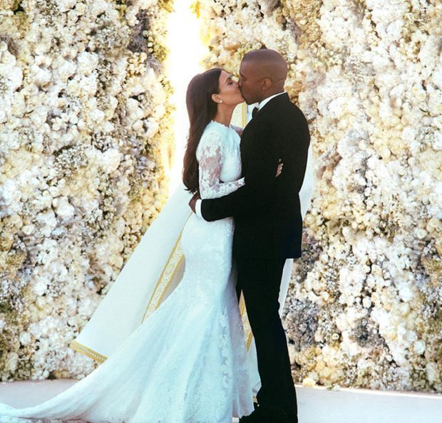 Kim Kardashian West and Kanye West kissing at their wedding in Florence, Italy. File photograph: E! News/PA Wire