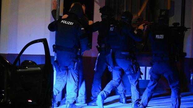 Austrian policemen search a civilian after gunfire in Vienna, Austria. Photograph: Christian Bruna/EPA
