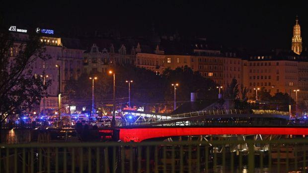 Ambulance cars near Schwedenplatz in Vienna, following a shooting incident. Photograph: Herbert Neubauer/APA/AFP via Getty Images