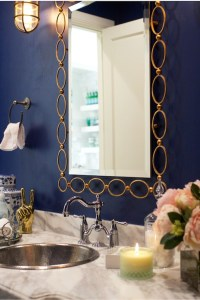 Blue wall with gold mirror