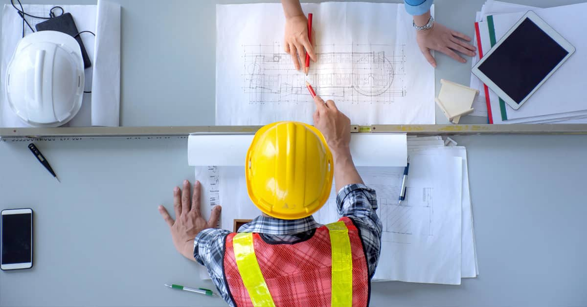 Construction Workers with Plans
