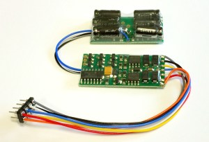 NCE D13NHP 1.3 Amp, 4 function, 8 pin NMRA plug, with small no halt module installed 524-0147