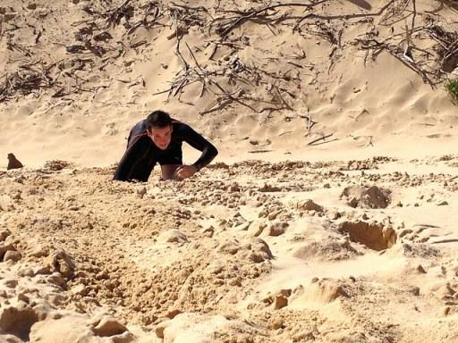 Participant makes his way through sand